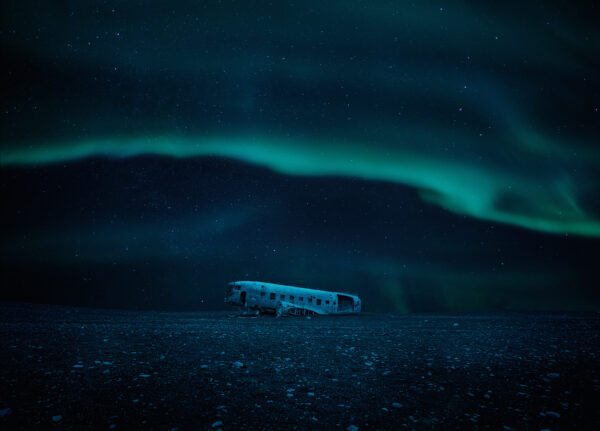 Plane wreck under the northern lights in Iceland