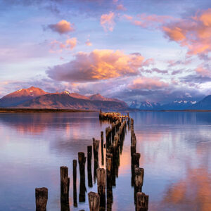 Sunrise over old jetty and mountains