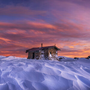 Mountain hut with snow